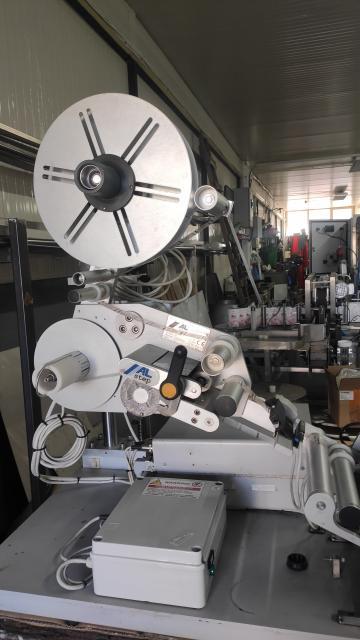 Aplicator semiautomat etichete pe suprafete cilindrice de la MGV Servicom Srl